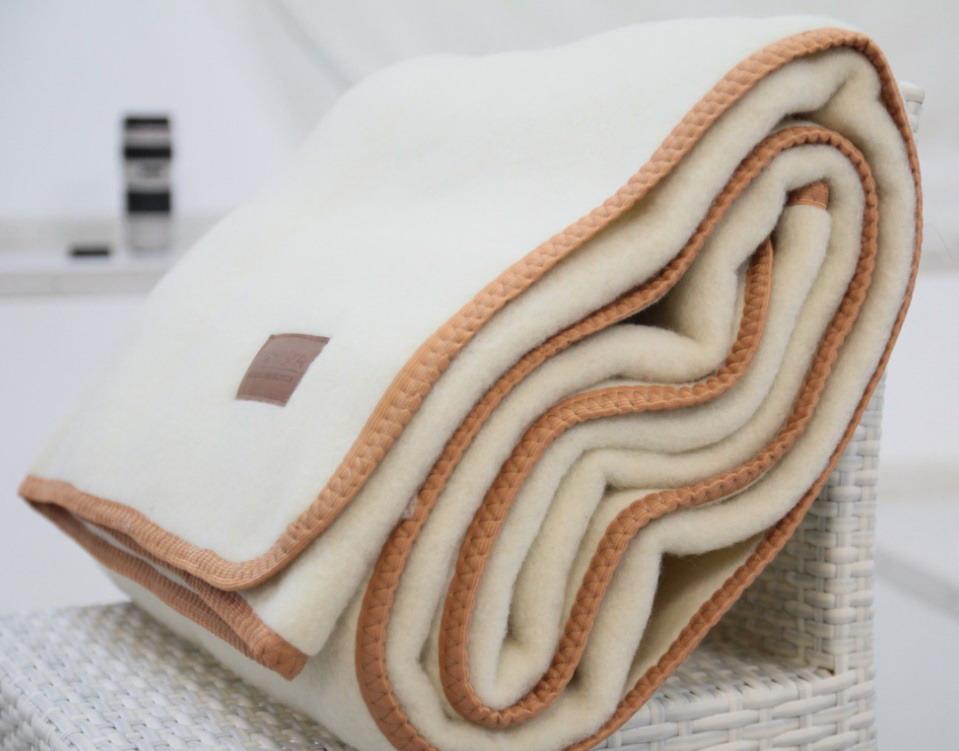 Особенности одеял из натуральной шерсти овцы — плюсы и минусы